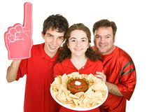Half Time Snack. Three football fans enjoying chips and salsa during half time. Isolated on white royalty free stock photography