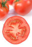 Half of a tomato. Isolated in white stock images