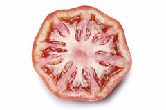 Half a tomato isolated over white. Stock Images