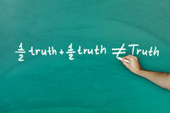 Half truth and half truth does not equal truth Stock Photo