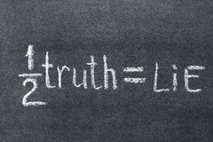 Half truth. Simple chalkboard interpretation of famous B.Franklin quote - half a truth is often a great lie stock photos