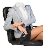 Half-turned woman body sitting in chair Stock Images