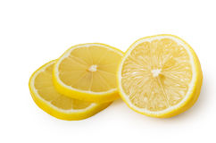 Half and two slices of lemon Royalty Free Stock Photo