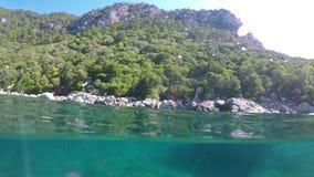 Half underwater landscape footage. Half underwater landscape footage with a big rock stock footage