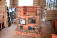 Half unfinished brick stove Stock Photos