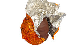 Half unwrapped chocolate foam kiss Royalty Free Stock Photo