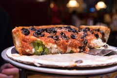 Half vegetarian deep dish Chicago pizza royalty free stock photos