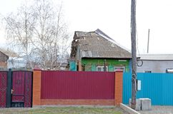 Half a village house. Even in this state, people live in the house. Russia. Siberia. Village.  Stock Image