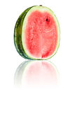 Half of watermelon with reflection on white background. Royalty Free Stock Photos