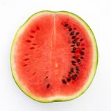 Half watermelon with seeds isolated on white from above. With rind stock images
