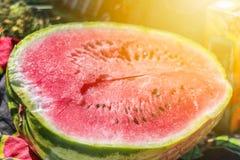 Half a watermelon on the store shelves,. Fruit vitamins Stock Photos
