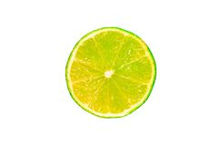 Half a wet lime. Closeup shot of half a wet lime, isolated against a white background stock images