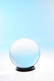 Half white half blue ball. Crystal ball bathed in half turquoise and half white light Stock Photography