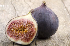 Half and a whole fig Royalty Free Stock Photography