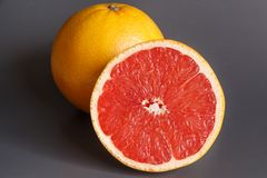 Half and whole grapefruits royalty free stock photography