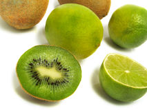 Half and whole kiwis and limes. A groups of half and whole fresh kiwis and limes isolated on white background Royalty Free Stock Photos