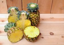 Half and whole pineapples Stock Photo