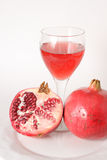 Half and whole pomegrante with juice,. Half and whole pomegranate with juice, ruby red in color Stock Image