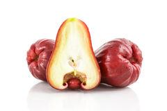 Half and whole red rose apple Royalty Free Stock Images