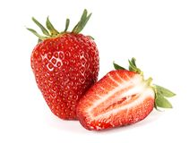 Half and whole strawberries Stock Image