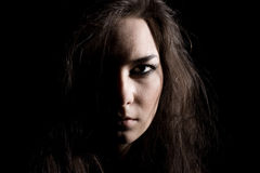 Half of women face in fur-capon Royalty Free Stock Image