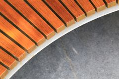 Half of wooden bench and cement. Exterior, design, interior, building, construction, copy, half, structure, material, pattern, wooden, bench, furniture, modern royalty free stock photo