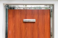 Half of wooden door entrance with stainless frame Royalty Free Stock Image