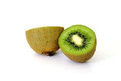 Halfed kiwi. Two halfs of a kiwi, white background stock images