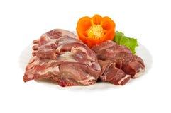 Halffabrikaten van everzwijnvlees worden gemaakt op de geïsoleerde die plaat, Royalty-vrije Stock Afbeelding