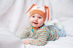 Halfjaarlijkse oude tandenloze baby Stock Afbeeldingen