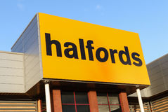 Halfords motorist centres sign with logo. Manchester, UK - January 5th 2015: Halfords motorist centres are key enants on many shopping malls including this one Stock Image