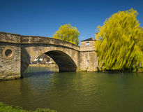 Halfpenny Bridge over the River Thames at Lechlade. Cotswold stone Halfpenny Bridge which spans the River Thames at Lechlade Royalty Free Stock Photography
