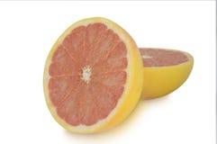 2 halfs грейпфрута изолированного на белой предпосылке Стоковые Фото