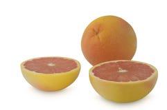 2 halfs и один грейпфрут на белой предпосылке Стоковое Фото