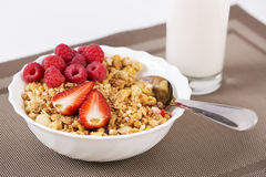 Halfs of berrie on cereals in bowl. Halfs of berrie on golden cereals in bowl stock photos