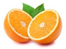 Halfs da laranja com folhas Imagem de Stock Royalty Free