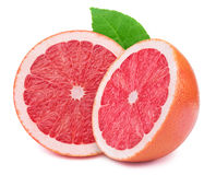 Halfs of grapefruits. Perfectly retouched sliced halfs of grapefruits with leaf  on the white background with clipping path Royalty Free Stock Photos