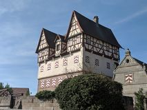 Halftimbered old castle in village stock photography
