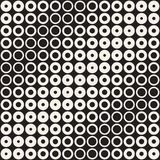 Halftone circles vector seamless pattern. Abstract geometric texture with size gradation of rings. Gradient transition. Effect monochrome background Stock Photos