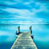 Halftone color. Abstract landscape. Wooden pier on Lake Zug in Switzerland. Long exposure Royalty Free Stock Images