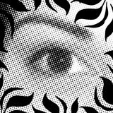 Halftone eye. A halftone eye illustration with a floral border- all in black and white Royalty Free Stock Photo