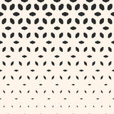 Halftone pattern. Vertical falling shapes, morphing rhombus Royalty Free Stock Image