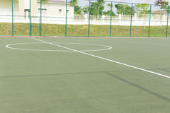 Halfway line and sphere shape marking at middle of futsal court Royalty Free Stock Photography
