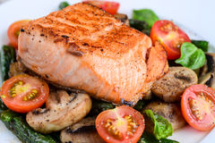 Halibut with balsamic cherry tomatoes and mushrooms Stock Photos
