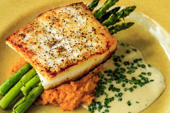 Halibut Filet with Asparagus and Sweet Potatoes Stock Photography