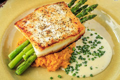 Halibut Filet with Asparagus and Sweet Potatoes Stock Photos