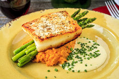Halibut Filet with Asparagus and Sweet Potatoes Stock Images