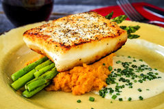 Halibut Filet with Asparagus and Sweet Potatoes Stock Photo