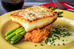 Halibut Filet with Asparagus and Sweet Potatoes Royalty Free Stock Image
