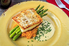 Halibut Filet with Asparagus and Sweet Potatoes Royalty Free Stock Photography
